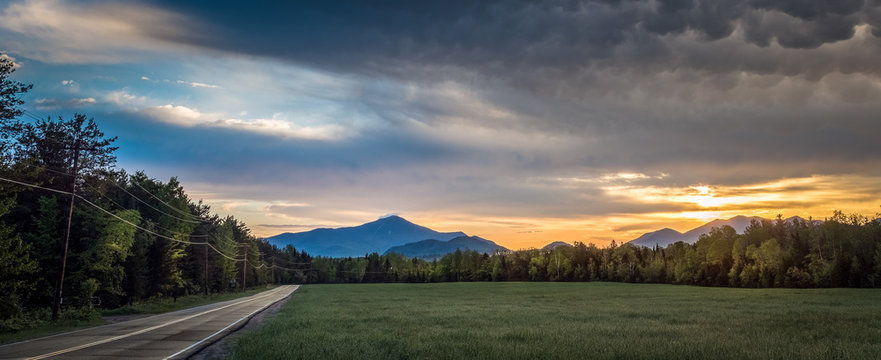 A panoramic view of sunrise with Whiteface Mountain in the background in the Adirondacks at Lake Placid, New York