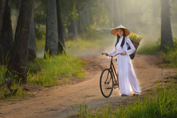 Asian woman dressed in traditional Vietnamese