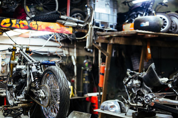 Background image  of disassembled motorcycle ready for repairing in mechanics garage