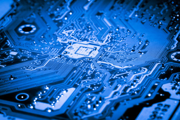 Abstract close up of Electronic Circuits in Technology on Mainboard computer background 