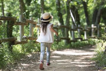 Little girl walking on the mountain path