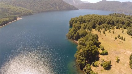 Aerial picture of a lake and forest in Chile