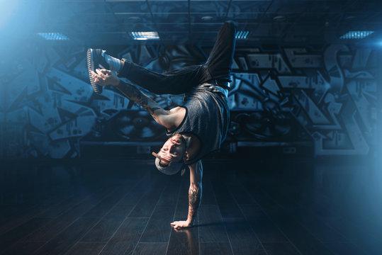 Breakdance action, dancer posing in dance studio