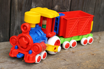 Multi-colored plastic locomotive in nature
