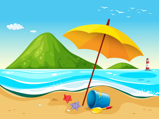 Beach scene with umbrella and toys