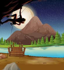 Man climbing rock on fullmoon night