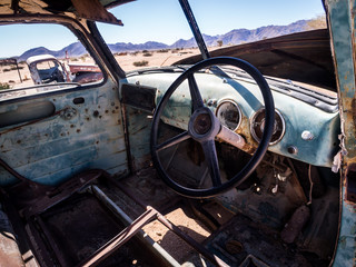 Old Chevrolet car wreck left in Solitaire on the Namib Desert, Namibia.