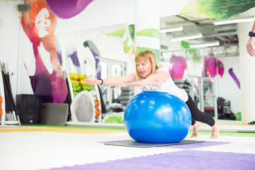 Senior woman doing pilates