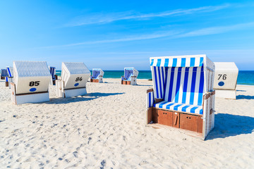 Wicker chairs on white sand Kampen beach, Sylt island, North Sea, Germany Fototapete