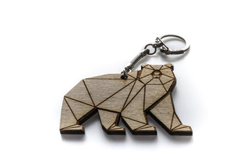 Wooden kodiak bear keychain closeup on white background