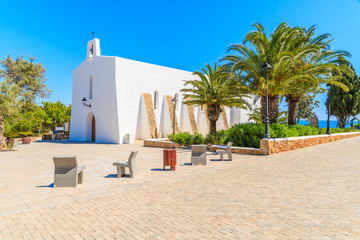 Fototapete - Typical white church and palm trees on square in Es Cubells village, Ibiza island, Spain