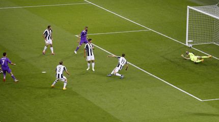 Real Madrid's Cristiano Ronaldo scores their first goal