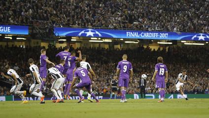 Juventus' Paulo Dybala shoots at goal from a free kick