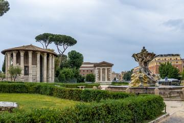 Tritons fountain and Temple of Hercules Victor (Tempio di Ercole Vincitore) on the Forum Boarium at Piazza Bocca della Verita (Mouth of the Truth) - Rome, Italy