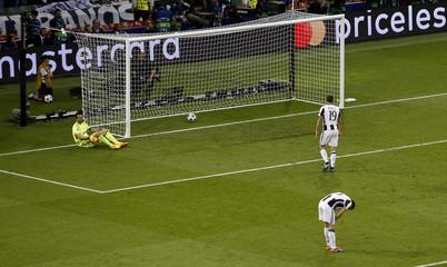 Juventus' Gianluigi Buffon looks dejected after Real Madrid's Casemiro scored their second goal