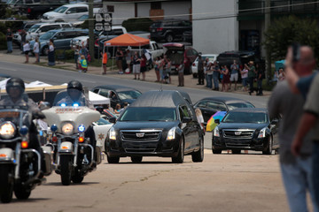 The funeral procession for the late Allman Brothers Band co-founder Gregg Allman heads into Rose Hill Cemetery in Macon