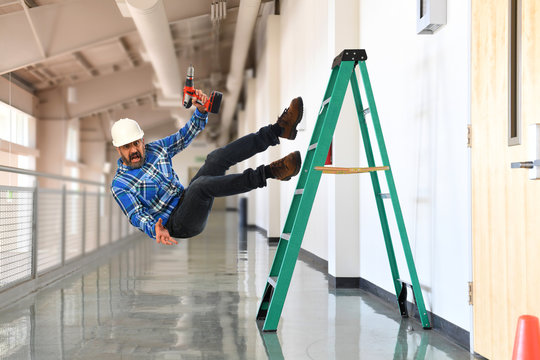 Construction worker falling off the ladder