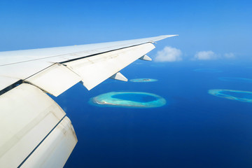 Maldives islands top view and airplane wing