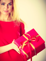Beautiful woman with big red gift.