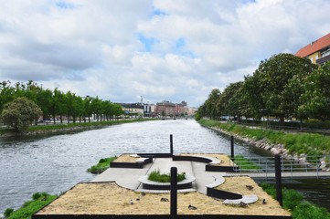 MALMO, SWEDEN - MAY 31, 2017: Palaces and park that overlook the canal of Malmo, Sweden