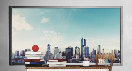 wooden table with books, with city view background