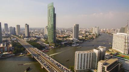 aerial view of sathorn bridge crossing chao praya river in heart of bangkok thailand