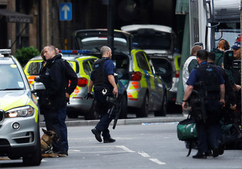 Armed police stand outside Borough Market after an attack left 6 people dead and dozens injured in London
