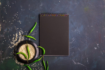 Black notepad for recording recipes, menus, timetables for Asian-style cafes in dark colors. Top View