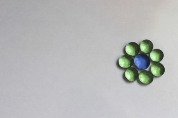 glass green flower, glass beads, glass flower on a white background