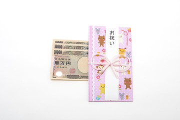 白背景のお祝いの袋と一万円札 Celebration bag with white background and 10,000 yen bill