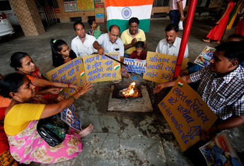 Fans offer special prayers for the victory of the Indian cricket team ahead of India and Pakistan ICC Champions Trophy match in Birmingham, inside a temple in Ahmedabad