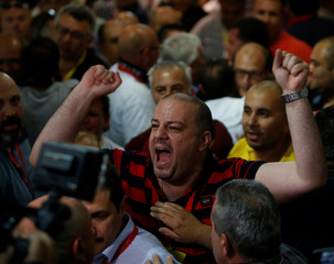 Labour Party delegates celebrate after claiming victory in Malta's snap general elections at the vote counting centre in Naxxar