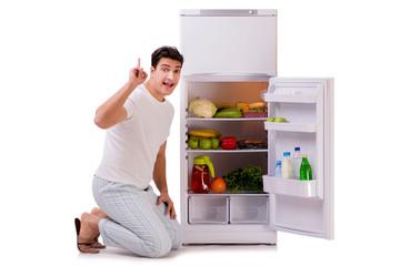 Man next to fridge full of food