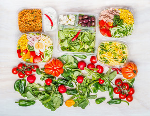Variety of Healthy salads in lunch boxes with ingredients white wooden background , top view