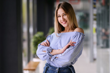 Beautiful blonde girl posing portrait indoors