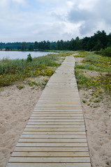Wooden path along the sandy shore of the Baltic Sea