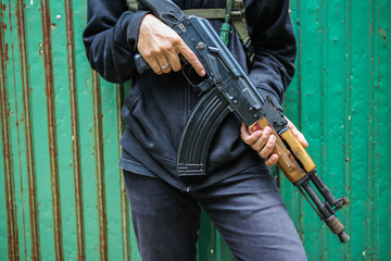Man hold assault rifles