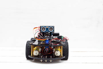 A riding robot on four wheels on a light background
