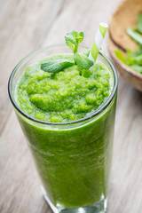 Rucola smoothie, on the grey  background.