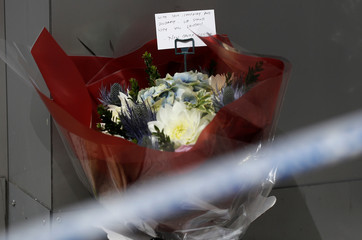 A bunch of flowers with a message of sympathy is seen near Borough Market after an attack left 7 people dead and dozens injured in London
