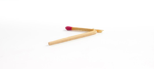 One broken match with rose match head on white background
