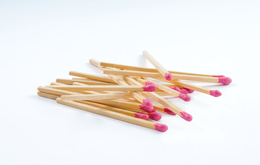 Pile of big matches with rose match head on white background