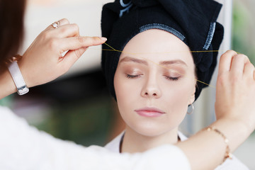 Master corrects eyebrows, gives shape and thread plucks eyebrows