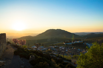 Panoramic and idyllic Andalusian landscape, mountain village Alcaudete at sunset