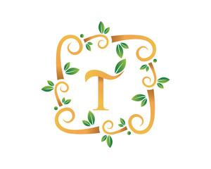 Elegant Floral T Letter With Gold Branch Logo