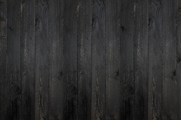 black wooden plank texture background.