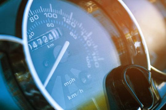 Round speedometer macro. The white arrow on the speedometer. The odometer