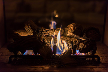 cozy romantic gas log fireplace in evening