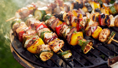 Poster Grill / Barbecue Grilled skewers on a grilled plate, outdoor
