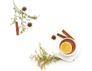 Tea set with herbs, ginger and anise on white background. Flat lay, top view, copy space